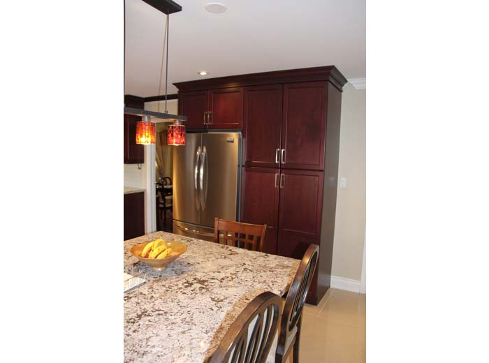 red cherry solid wood custom kitchen by millo kitchens and baths