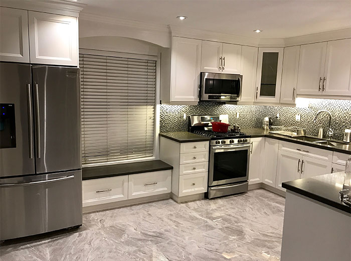 Solid Maple Cabinets Painted in Cloud White