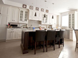 Custom cabinets painted white with accent island stained to dark chocolate