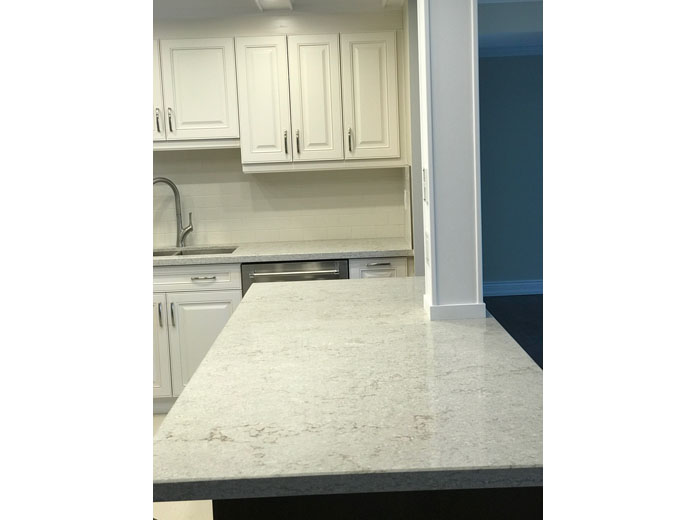 Quartz Kitchen Island With Custom Kitchen Cabinets in White