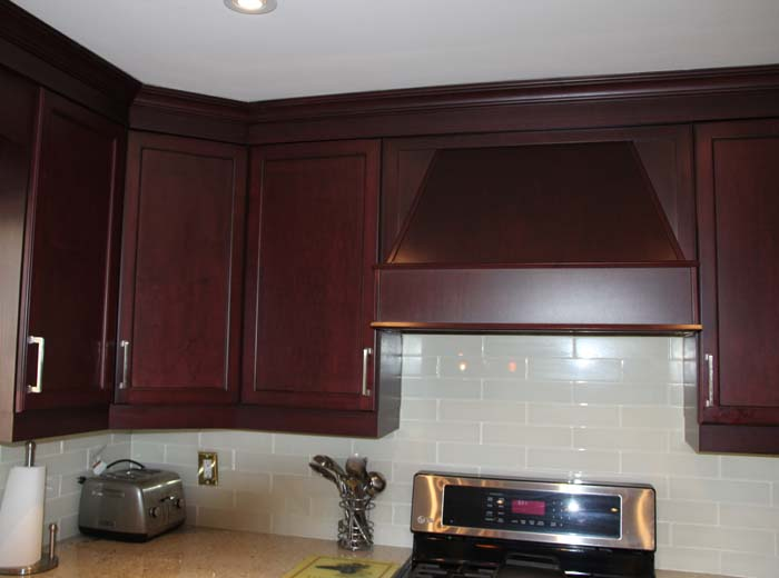 Kitchen cabinet with custom hood