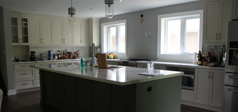 Contemporary Kitchen with Shaker Style Solid Cabinets Painted in White