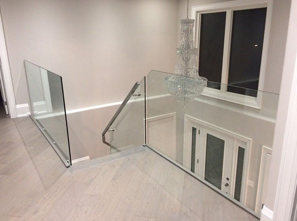 Glass stairwell & walls with chrome handrails