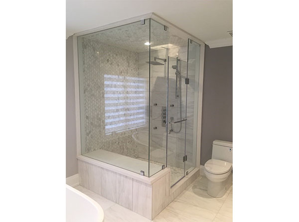 Custom glass & tile combo shower with sitting area