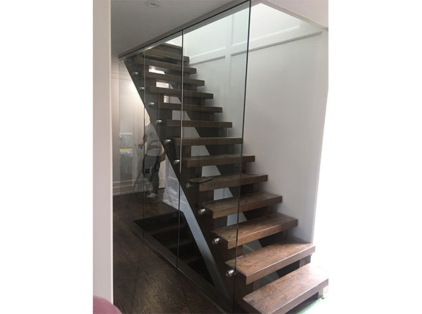 Custom glass encasing staircase with chrome glass clamps