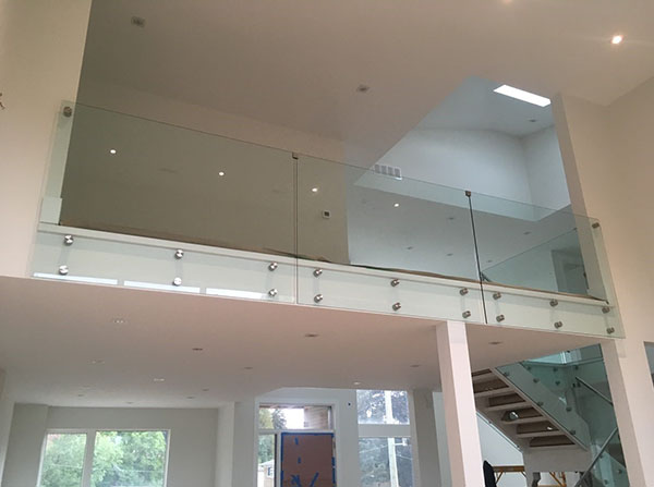 Custom glass wall with chrome glass clamps