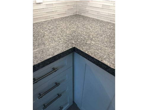 Quartz Countertop with Glass Backsplash
