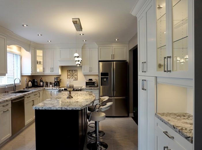 After renovation - open kitchen transitional style with maple cabinets