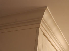 Decorative crown moulding on custom kitchen cabinets