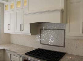 Custom Hood with Decorative Backsplash