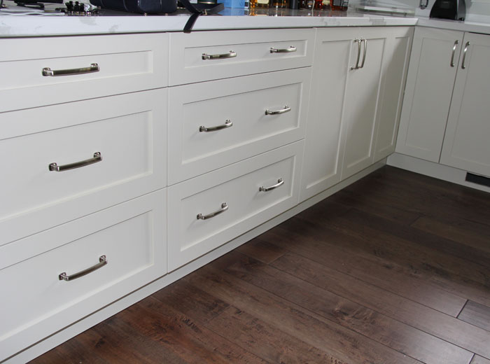 White Cabinetry with Dark Brown Hardwood Flooring